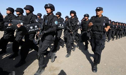 Lính Trung Quốc tham gia diễn tập chống khủng bố tại khu tự trị Tân Cương hồi tháng 7/2017. Ảnh: Reuters.