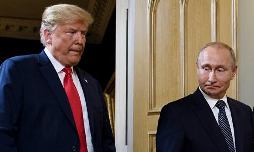 Tổng thống Nga Putin (phải) và Tổng thống Mỹ Trump tại Phần Lan ngày 16/7. Ảnh: AFP.