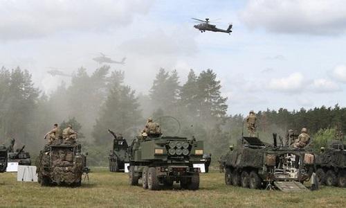 Binh sĩ NATO trong một cuộc tập trận hồi tháng 6. Ảnh: AFP.