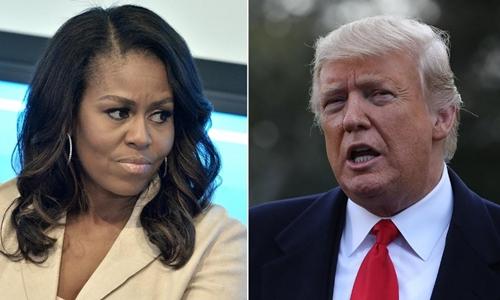 Tổng thống Mỹ Trump (phải) và cựu đệ nhất phu nhân Michelle Obama. Ảnh: CNN.
