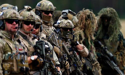 Binh sĩ NATO trong một đợt tập trận chung năm 2016. Ảnh: AFP.