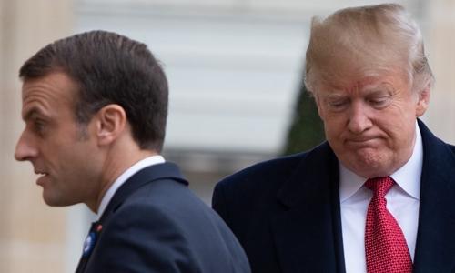 Trump (phải) và Macron tại Paris ngày 10/11. Ảnh: AFP.