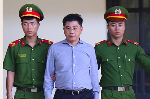 Nguyễn Văn Dương, cựu chủ tịch CNC, trong sáng 21/11 đã phủ nhận các lời khai của ông Hóa. Ảnh: Phạm Dự