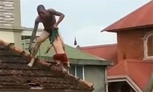 Cảnh sát không chế nghi phạm ngáo đá ném con trai từ tầng hai xuống đất