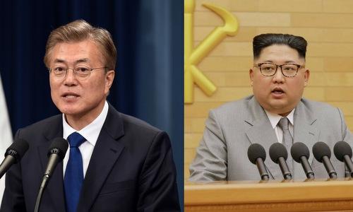 Tổng thống Hàn Quốc Moon Jea-in và lãnh đạo Triều Tiên Kim Jong-un. Ảnh: Reuters.
