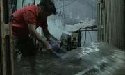Người Sài Gòn tát nước ngập nhà sau bão Usagi