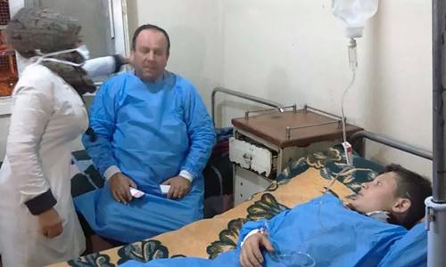 Syria công bố ảnh nạn nhân hít khí độc được điều trị tại Aleppo ngày 24/11. Ảnh: AFP.