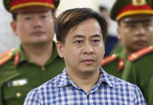 Phan Văn Anh Vũ tại TAND Hà Nội hồi tháng 7. Ảnh: TTXVN.