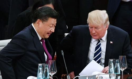 Tổng thống Mỹ Trump, phải, và Chủ tịch Trung Quốc Tập Cận Bình, cùng dự G20 năm nay tại Argentina. Ảnh: SCMP.