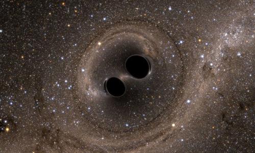 Hai hố đen trong quá trình hợp nhất. Ảnh: Sun.