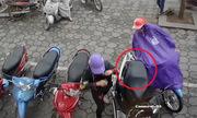 Trá»m dùng chiêu mặc áo mÆ°a Äá» móc túi xách trong cá»p xe máy