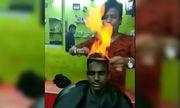 Salon Ấn Độ đốt lửa cắt tóc cho khách