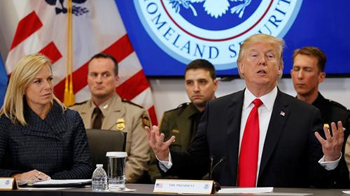 Donald Trump and Homeland Security Secretary Kirstjen Nielsen speak at a meeting in February.JONATHAN ERNST / REUTERS