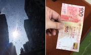 Người đàn ông rải mưa tiền gây náo loạn đường phố Hong Kong