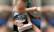 Anh phá băng nhóm Việt trồng cần sa từ video em bé chơi với xấp tiền