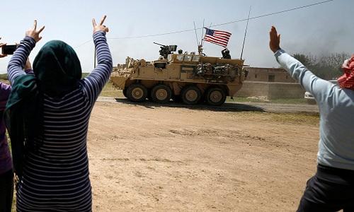 Xe quân sự tiến vào một tỉnh miền bắc Syria do lực lượng người Kurd kiểm soát hồi tháng 4. Ảnh: Reuters.