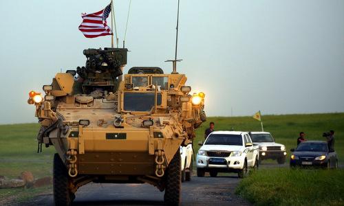 Đoàn xe đặc nhiệm Mỹ và YPG ở phía bắc Syria. Ảnh: Reuters.