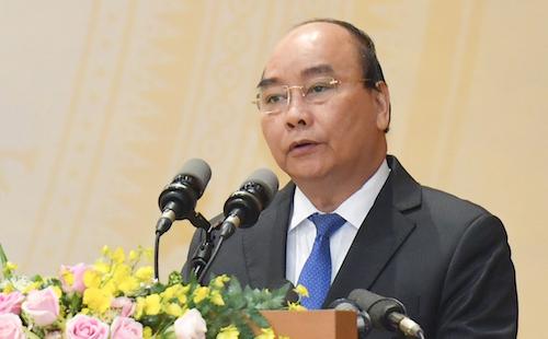 Thủ tướng Nguyễn Xuân Phúc phát biểu tại hội nghị Chính phủ với các địa phương ngày 28/12. Ảnh: VGP