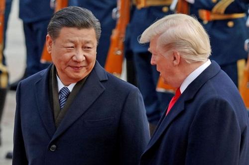 Tổng thống Mỹ Donald Trump (phải) và Chủ tịch Trung Quốc Tập Cận Bình trong cuộc gặp tại Bắc Kinh năm 2017. Ảnh: Reuters.