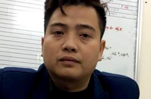 Nghi phạm Đỗ Đăng Trung tại trụ sở công an.