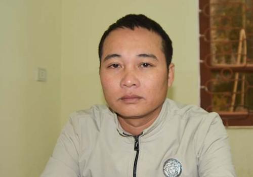 Nghi can Tính tại cơ quan công an. Ảnh: Quỳnh Trang.