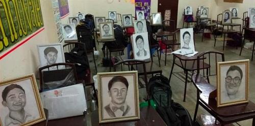 Tranh vẽ từng học sinh được cô giáo đặt ở chỗ ngồi trong lớp. Ảnh:Roselyn Barcoma