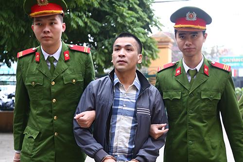 Bùi Mạnh Quốc là một trong hai bị cáo bị tạm giam trong vụ án. Ảnh: Phạm Dự.