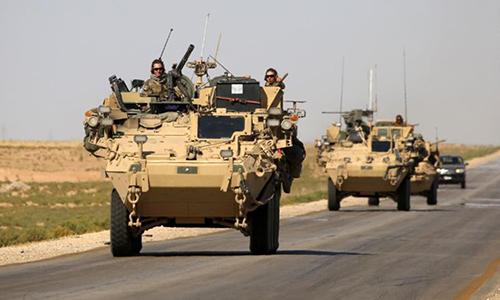 Binh sĩ Mỹ tuần tra tại Syria. Ảnh: AFP.