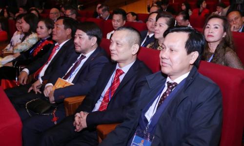 Anh Ngô Hải, thứ hai từ phái sang, dự Xuân Quê hương 2019. Ảnh: Giang Huy.