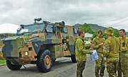 Lũ lụt khiến cá sấu tràn vào phố, Australia điều quân đội đối phó