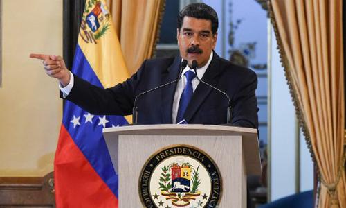 Tổng thống Venezuela Maduro phát biểu tại Caracas hôm 8/2, tuyên bố sẽ không dựa vào số viện trợ rởm của Mỹ đang nằm ở biên giới Colombia theo yêu cầu từ lãnh đạo phe đối lập Juan Guaido. Ảnh: AFP.