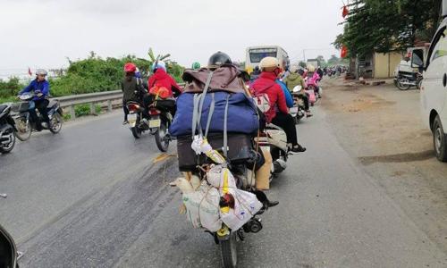 Chuyến xe chở cả quê hương quay lại thành phố sau Tết - 3