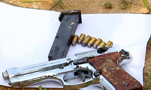 Tìm thấy súng, lựu đạn ở hiện trường nhóm buôn ma túy cố thủ