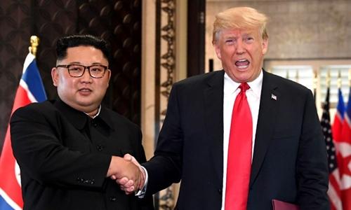 Tổng thống Mỹ Trump và lãnh đạo Triều Tiên Kim Jong-un tại Singapore tháng 6 năm ngoái. Ảnh: AFP.