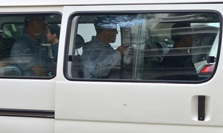 Các quan chức trong đoàn tiền trạm Triều Tiên ở Hà Nội. Ảnh: Vũ Anh.