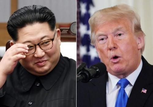 Tổng thống Mỹ Trump, phải, và lãnh đạo Triều Tiên Kim Jong-un. Ảnh: AFP.