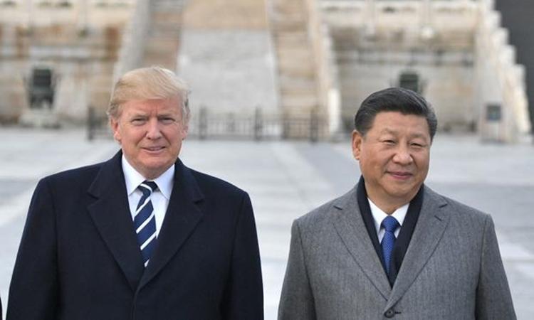 Tổng thống Mỹ Donald Trump (trái) và Chủ tịch Trung Quốc Tập Cận Bình. Ảnh: AFP.