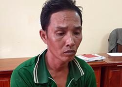 Huỳnh Văn Phết tại cơ quan công an. Ảnh: Lan Vy