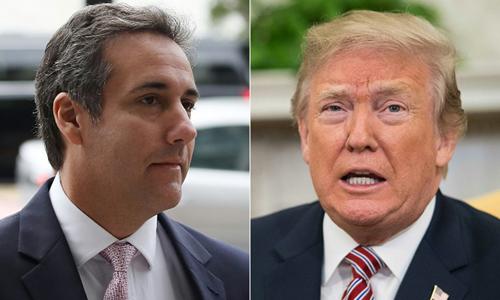 Tổng thống Mỹ Donald Trump (phải) và cựu luật sư Michael Cohen. Ảnh: AFP.