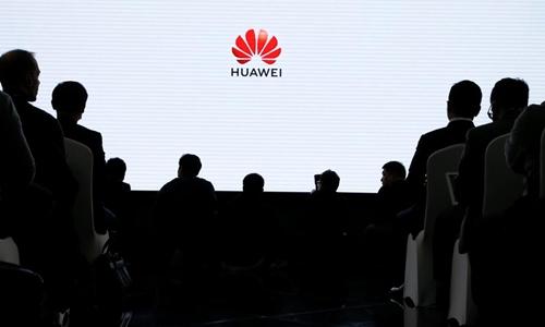 Một buổi ra mắt sản phẩm của Huawei ở Bắc Kinh ngày 29/1. Ảnh: AFP.