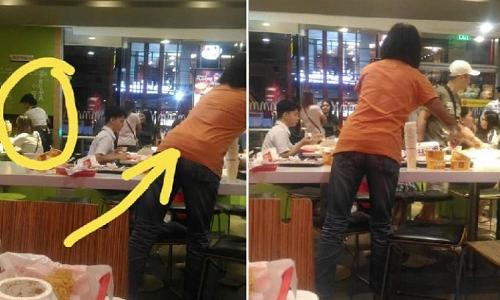 Bà Emelia (áo cam) giúp đỡ con gái là nhân viên làm thêm tại cửa hàng McDonalds. Ảnh: Facebook