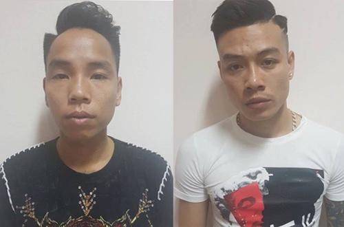 Hai trong số tám nghi phạm bị tạm giữ. Ảnh: L.N.