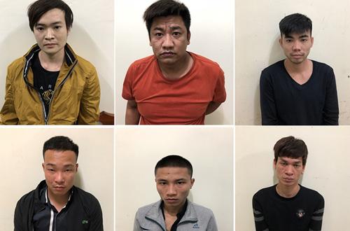 Sáu nghi phạm liên quan cho vay nặng lãi, cưỡng đoạt tài sản bị tạm giữ. Ảnh: M.H.