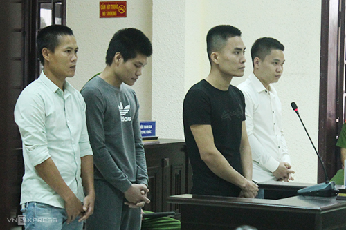 Bốn bị cáo tại phiên toà. Ảnh: Bảo Hà
