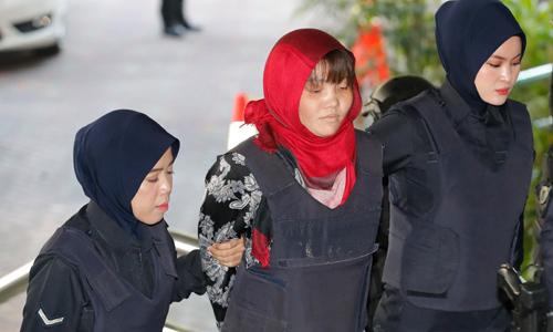 Nghi phạm Đoàn Thị Hương trong phiên tòa sáng 14/3. Ảnh: AP.