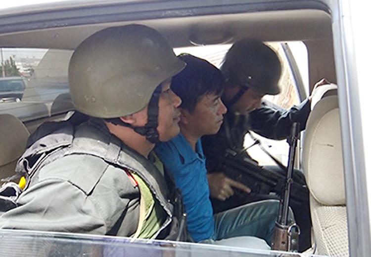 Nghi can người Trung Quốc bị bắt. Ảnh: Q.T