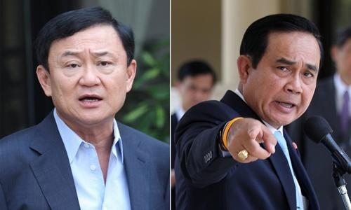 Cựu thủ tướng Thái Lan Thaksin Shinawatra (trá), lãnh đạo đảng đối lập Pheu Thai, và Thủ tướng Prayut Chan-o-cha. Ảnh: Nation.