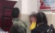 Hạ sĩ quan Trung Quốc bị sa thải vì tát nữ sinh