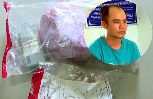 Phương và số tiền, vàng trong vụ cướp. Ảnh: An Phú.