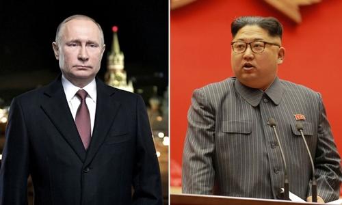 Tổng thống Nga Putin (trái) và lãnh đạo Triều Tiên Kim Jong-un. Ảnh: Kremlin/KCNA.